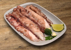Red boiled octopus plate. The texture on the table. Market Stock Photography
