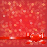 Red Bokeh Background With Bow Stock Photo
