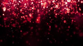 Red bokeh background with falling glitter particles. Beautiful festive sparkling background. Valentines day. Seamless loop