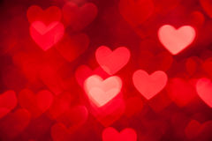 Red bokeh of hearts background Stock Photos