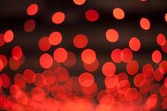 Red bokeh lights on dark broun backgroung. Red bokeh on dark stock image