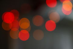 Red bokeh shimmering blur spot lights. On abstract background stock photo