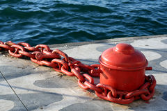 Red bollard. Image of a red bollard by the sea Stock Photography