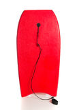 Red boogie board on a white background. A red boogie board on a white background royalty free stock photos