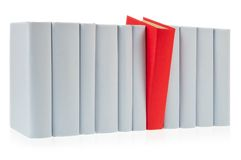 Red book. Falls out of row of grey books Royalty Free Stock Images