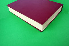 Red book. Isolated on Green Stock Photography