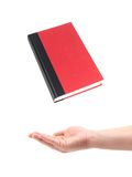 Red Book. A red book and a hand isolated against a white background Stock Images