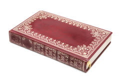Red book bound in leather. Gilded leather-bound book isolated on white Stock Image