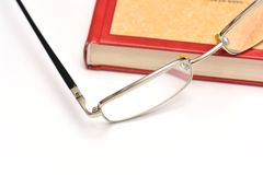 Red book and glasses Royalty Free Stock Image