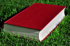 Red Book On Green Grass Royalty Free Stock Photography