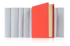 Red book & grey books. Red book ahead of row from grey books on white Stock Photo