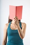 Red book in her face Stock Photography