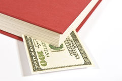 Red Book With Hundred Dollar Bill and Shadow Royalty Free Stock Images