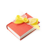 Red book isolated. Red gift book with the yellow decorational bow over it, composition isolated over the white background Stock Photo