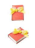Red book isolated. Red gift book with the yellow decorational bow over it, composition isolated over the white background, set of two different foreshortenings Royalty Free Stock Photos