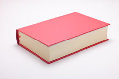 Red book isolated on white. Book with a red hardcover, isolated on white Royalty Free Stock Images