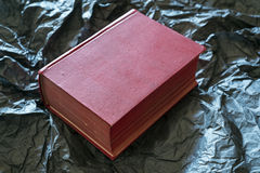 Red book. An old red book on black paper Royalty Free Stock Photos