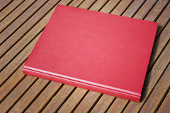 Red book on the outdoor table at coffee shop Royalty Free Stock Image