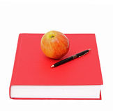 Red book, pen and an apple Stock Photography