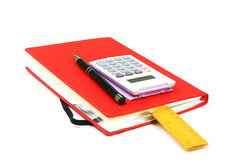 Red book,pen,calculator and ruler Royalty Free Stock Image
