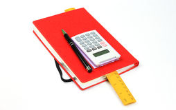 Red book,pen,calculator and ruler Royalty Free Stock Photo