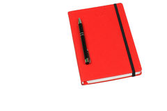 Red book and pen Stock Photos