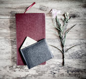 Red book with a purse and credit cards on a wooden background. Stock Photos