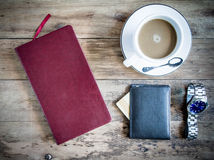 Red book with a purse and credit cards on a wooden background. Royalty Free Stock Images
