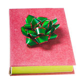 Red book with red green bow Royalty Free Stock Photos