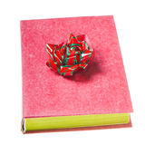 Red book with red green bow Royalty Free Stock Photo