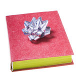 Red book with silver bow Royalty Free Stock Photography