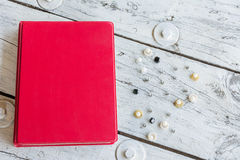 Red book on table Royalty Free Stock Image