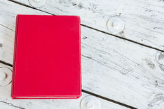 Red book on table Royalty Free Stock Photo