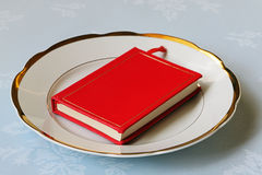 Red book on white chinaware Stock Photography