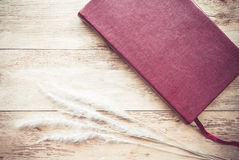 Red book on wood background Stock Photo
