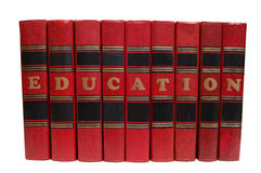 Red books. In a row with the words education. Isolated on white Stock Photography