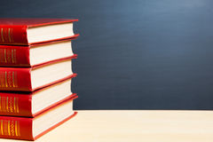 Red books and blackboard Royalty Free Stock Photography