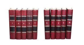 Red books covers with serial numbers. Retro book collection ten volumes, textured leather. White background, soft focus Stock Photo