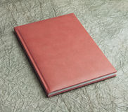 Red  books in leather cover on a design paper, identity design,. Corporate templates, company style Stock Images
