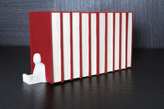 Red books. A pile of red books on a wooden shelf Stock Photography