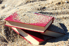 Red books on the sand Stock Image