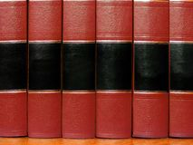 Red Books on Shelf. Row of old red leather books on a shelf with blank covers Stock Images