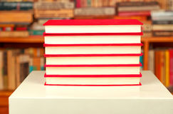 Red books on a white table. Reading concept Royalty Free Stock Photography