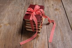 Books wrapped with color ribbon, on wooden table Royalty Free Stock Image
