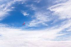 Red boomerang in flight Stock Photography