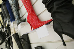 Red boot on a high heel. In shoe shop Stock Images