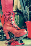 Red Boot on Sewing Machine Pedal Royalty Free Stock Photos