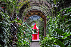 Red booth in botanical garden in Puerto de la Cruz Royalty Free Stock Photography