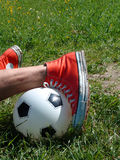 Red boots 007. Accident at playing soccer. June 2006 royalty free stock photo