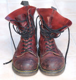 Red boots. Some old battered boots Stock Image